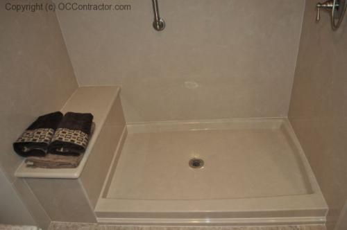 A Bathroom with Staron Countertop Shower with Bench Seat Custom Dark Oak Cabinetry Vinyl Flooring (14) lg