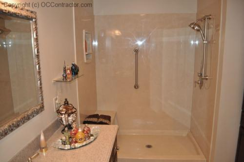 A Bathroom with Staron Countertop Shower with Bench Seat Custom Dark Oak Cabinetry Vinyl Flooring (16) lg
