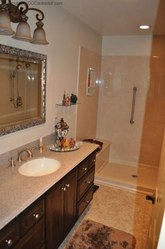 A Bathroom with Staron Countertop Shower with Bench Seat Custom Dark Oak Cabinetry Vinyl Flooring (17) lg