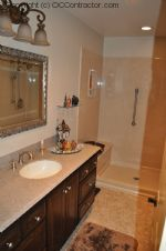 A Bathroom with Staron Countertop Shower with Bench Seat Custom Dark Oak Cabinetry Vinyl Flooring (17) sm