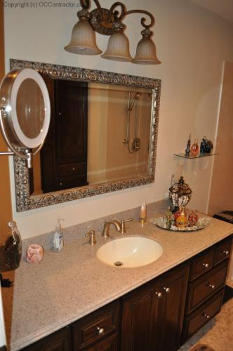A Bathroom with Staron Countertop Shower with Bench Seat Custom Dark Oak Cabinetry Vinyl Flooring (18) lg