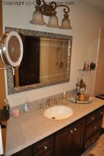 A Bathroom with Staron Countertop Shower with Bench Seat Custom Dark Oak Cabinetry Vinyl Flooring (18) sm