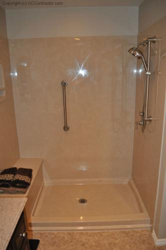 A Bathroom with Staron Countertop Shower with Bench Seat Custom Dark Oak Cabinetry Vinyl Flooring (19) lg