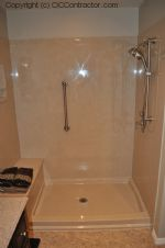 A Bathroom with Staron Countertop Shower with Bench Seat Custom Dark Oak Cabinetry Vinyl Flooring (19) sm