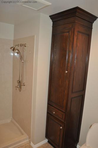 A Bathroom with Staron Countertop Shower with Bench Seat Custom Dark Oak Cabinetry Vinyl Flooring (20) lg