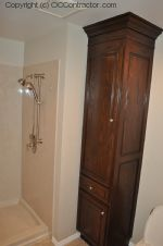 A Bathroom with Staron Countertop Shower with Bench Seat Custom Dark Oak Cabinetry Vinyl Flooring (20) sm