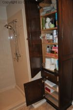 A Bathroom with Staron Countertop Shower with Bench Seat Custom Dark Oak Cabinetry Vinyl Flooring (21) sm