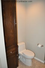 A Bathroom with Staron Countertop Shower with Bench Seat Custom Dark Oak Cabinetry Vinyl Flooring (22) sm