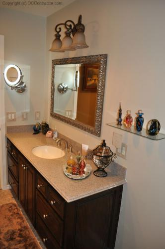 A Bathroom with Staron Countertop Shower with Bench Seat Custom Dark Oak Cabinetry Vinyl Flooring (23) lg