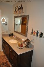 A Bathroom with Staron Countertop Shower with Bench Seat Custom Dark Oak Cabinetry Vinyl Flooring (23) sm