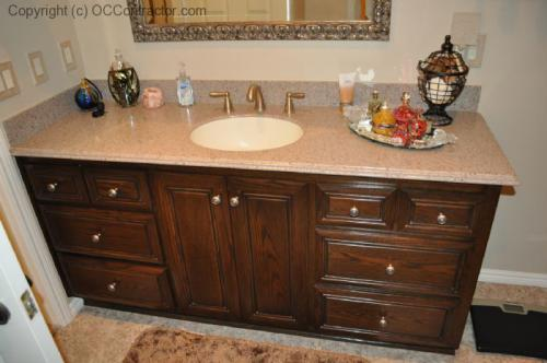 A Bathroom with Staron Countertop Shower with Bench Seat Custom Dark Oak Cabinetry Vinyl Flooring (24) lg