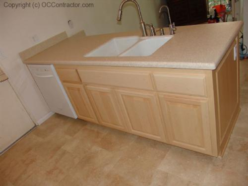 Kitchen with Light Maple Cabinetry and Staron Countertops (7) lg