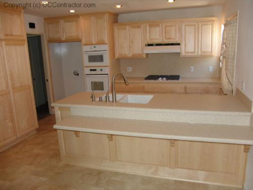 Kitchen with Light Maple Cabinetry and Staron Countertops (8) lg