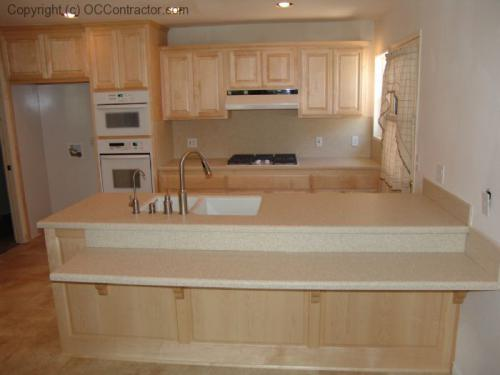 Kitchen with Light Maple Cabinetry and Staron Countertops lg