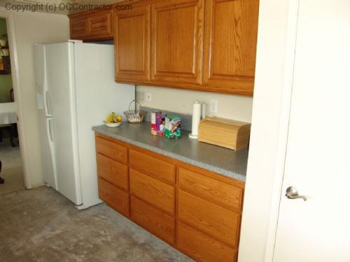 Kitchen with Staron Countertop and Unfinished floor lg