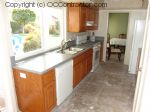 Kitchen with Staron Countertops and Unfinished Floor sm